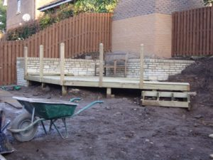 Decking reconstruction and retaining wall